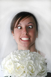 lovely bride smiling yet looking crazed with her eyes crossed