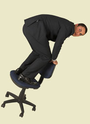 businessman standing on teetering office chair