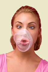 young woman with bubblegum popped all over her face